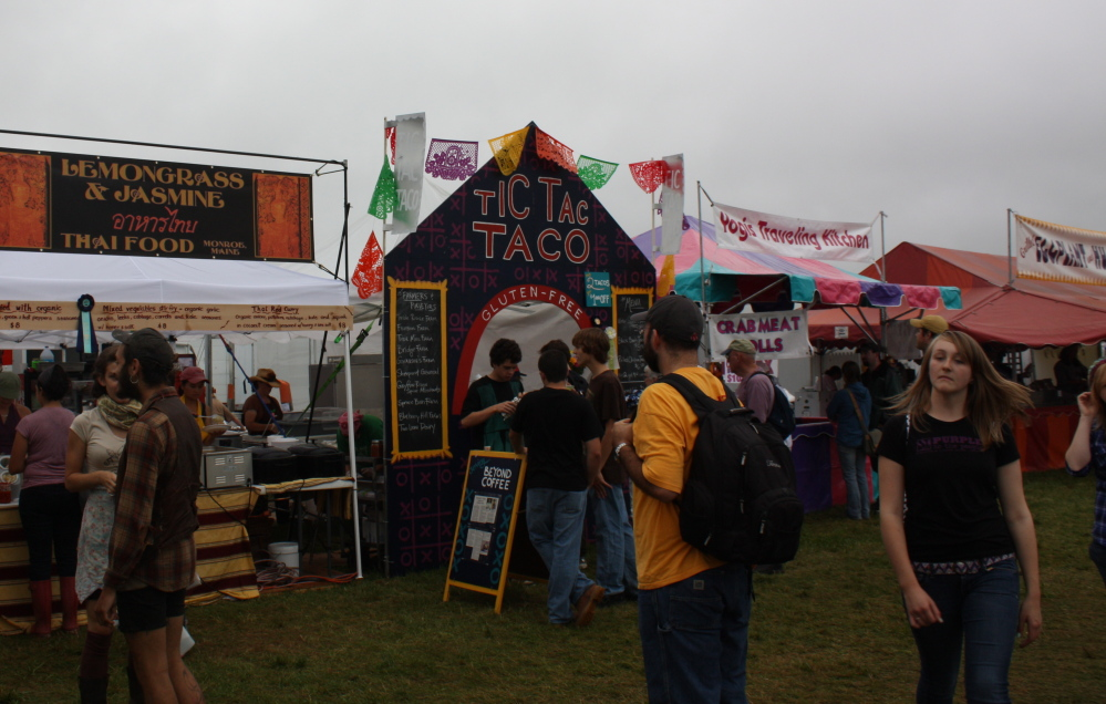 Food vendors line the Common Ground Country Fair food court, offering Thai stir fries, gluten-free vegan tacos and hummus-and-eggplant sandwiches.