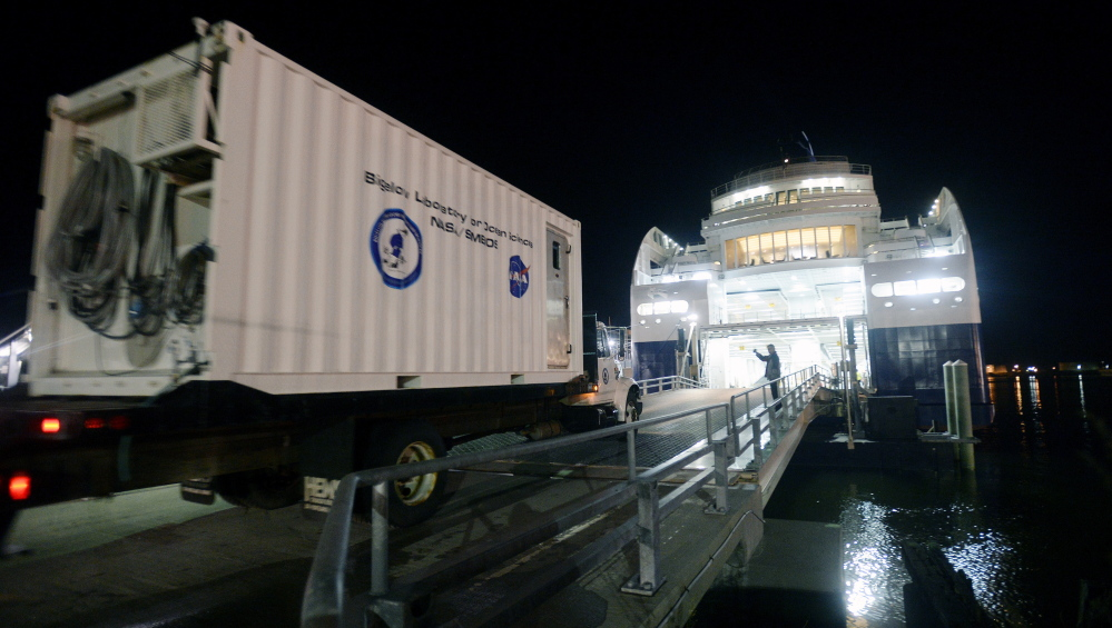 A truck carrying a Bigelow Lab container equipped for research is driven into the lower section of the Nova Star ferry this month. Water samples taken along the ship's 207-mile route across the Gulf of Maine are used to validate data collected by NASA satellites.