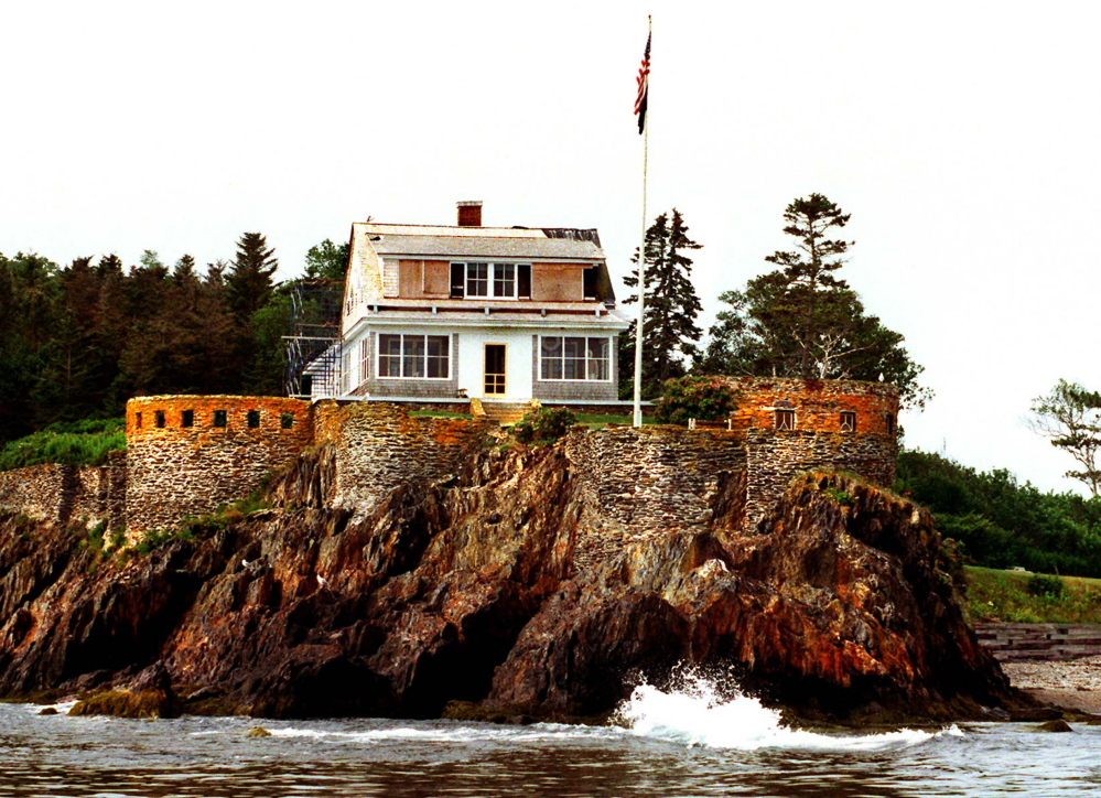 The Eagle Island home of Adm. Robert Peary sits atop a water-lapped ledge in this photo taken prior to some repairs being made.