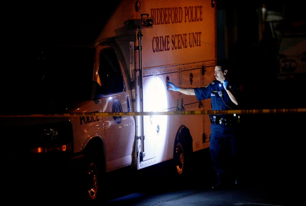 The Biddeford police crime scene unit is parked at the Sleepy Hollow Motel on Tuesday night as police investigate the discovery of two bodies.