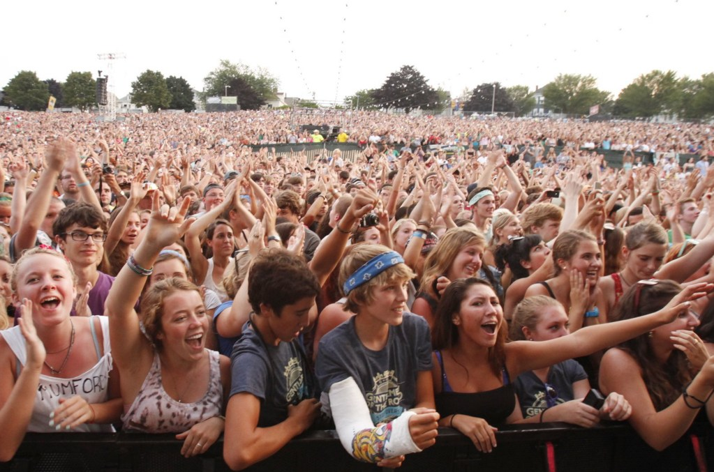 Fans cheer at the end of Mumford & Sons' first song during their concert  on the Eastern Prom in Portland on Aug. 4, 2012. While the concert was widely considered a success, Portland city councilors  raised some concerns during Monday night's meeting. Press Herald file photo