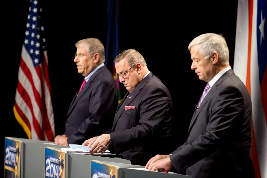 Maine's three candidates for governor, from left independent Eliot Cutler, Republican Gov. Paul LePage and Democratic U.S. Rep. Mike Michaud, look over their notes as they prepare for Tuesday night's debate at WMTW-TV's studio in Auburn.