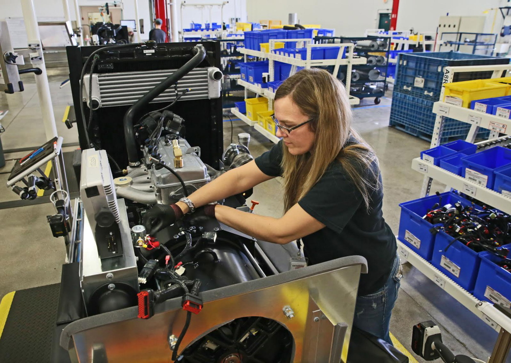 Kristy Westenberg works at Generac in Whitewater, Wisc. Westenberg was the first female in her current job as an equipment tester at the plant.