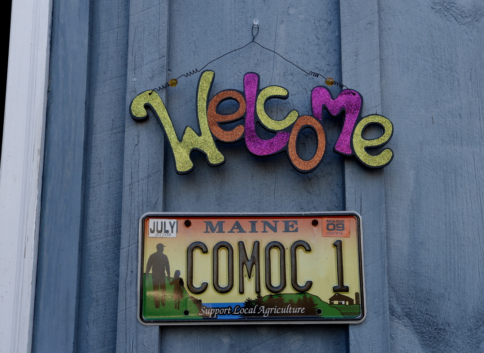 """A """"COMOC"""" license plate is the only clue to the new location of Crown O' Maine Organic Cooperative in North Vassalboro. Leah Cook says they haven't gotten around to putting up a sign yet."""
