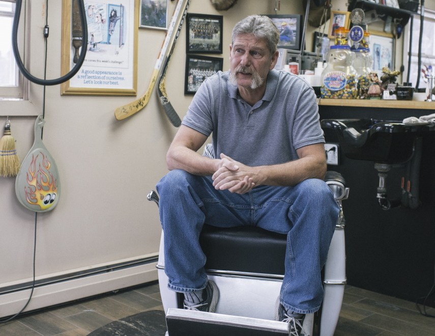 """Ron Miller sits in his barbershop in Greene, a town that voted heavily for Paul LePage. """"With our town, there was no doubt we would vote (for)LePage. ... The way I look at things, being a barber now, and a U.S. Navy diver for 20 years, I'm not politically correct at all. But the one thing about here, is your opinions matter. I like to hear all sides,"""" Miller said."""