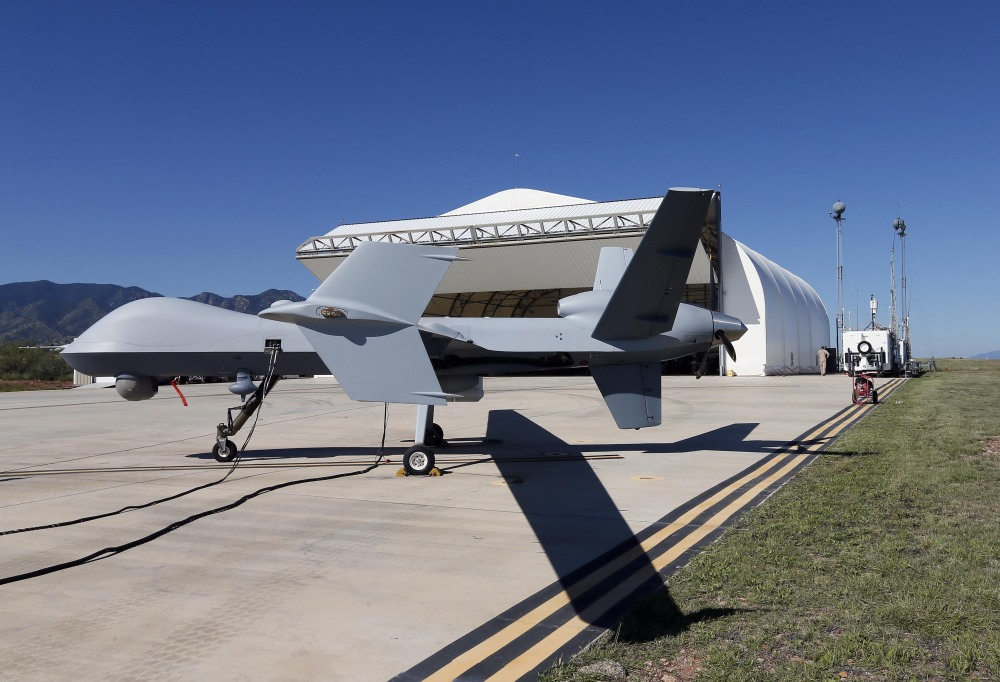 A drone aircraft is prepped prior to its flight from Ft. Huachuca in Sierra Vista, Ariz., for an unmanned patrol of the U.S.-Mexican border.