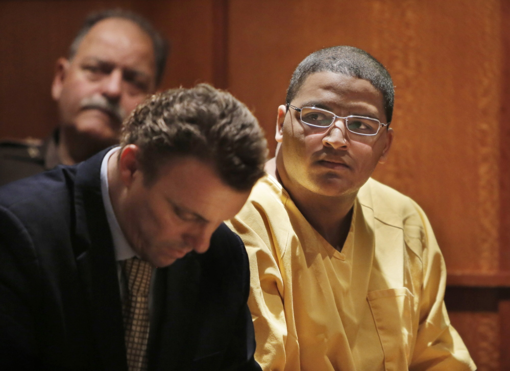 At his sentencing hearing in Cumberland County Courthouse in Portland on Wednesday, Anthony Pratt, Jr. listens as Deputy Attorney General Lisa Marchese addresses the court.