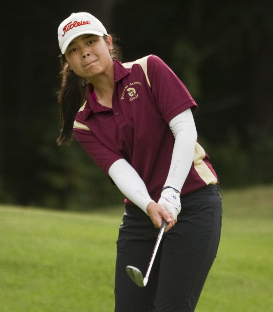 """Hashilla Rivai, a junior at Thornton Academy, is a native of Jakarta, Indonesia. """"Hashilla plays one shot at a time and doesn't dwell on bad shots. She focuses on the next shot,"""" said Coach Jeff Camire."""