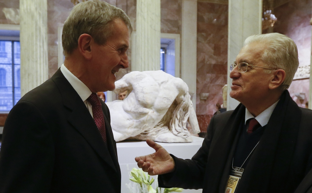 Hermitage director Mikhail Piotrovsky, right, and British Museum director Neil MacGregor confer in front of the sculpture of Ilissos at the exhibition on Greek art.