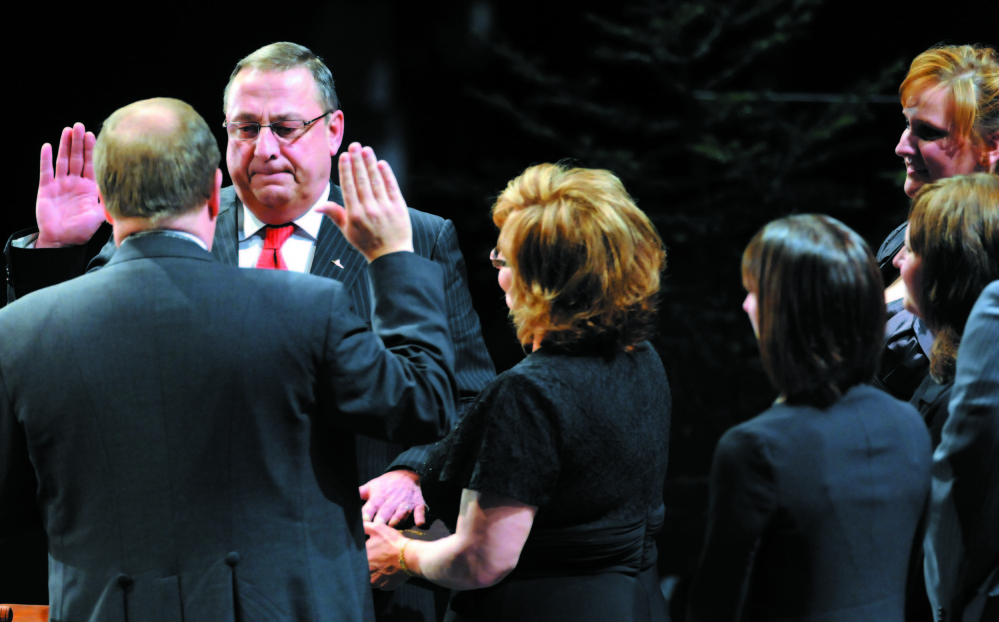 Gov. Paul LePage takes the oath of office at the start of his first term, in 2011.