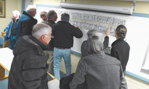RESIDENTS EXAMINE PLANS for reconstruction of North Street this summer following a presentation on the project Wednesday at City Hall. City officials and Jennifer Claster, a landscape architect for Wright-Pierce, said now is the time to hear concerns from residents and learn details about this portion of the road before plans are finalized.