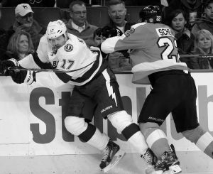 TAMPA BAY LIGHTNING'S Alex Killorn, left, is hit by Philadelphia Flyers' Luke Schenn during the second period of an NHL hockey game on Monday, in Philadelphia.