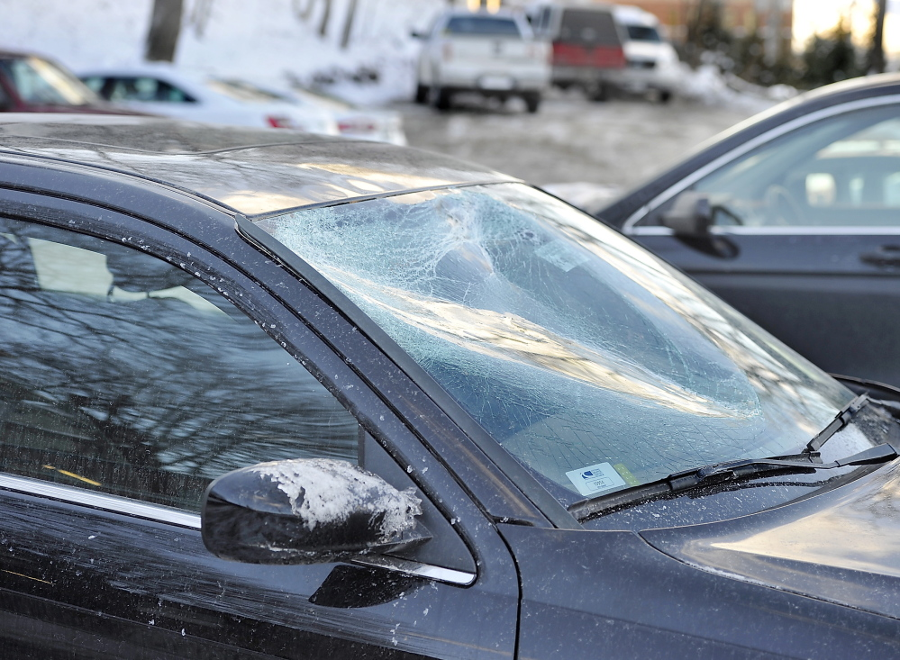 A chunk of ice caved in the windshield of Heather Rossignol's car Sunday while she was driving on the Maine Turnpike in Scarborough. She was able to safely pull off the highway.