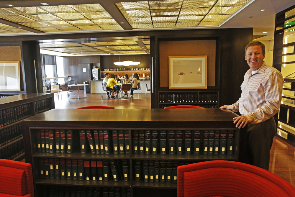 """Managing partner Greg Koltun shows off the """"loungebrary"""" at the law firm Morrison & Foerster. The Los Angeles firm scaled back its library to create a communal hang-out space. (Los Angeles Times/Anne Cusack)"""