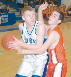 MORSE FORWARD Ethan Winglass looks to the basket while being guarded by Camden Hills' Noah Heidorn in a KVAC Class B boys basketball game at Bath Middle School on Tuesday. Winglass scored his 1,000th career point on the play as the Shipbuilders rolled to a 68-40 win.