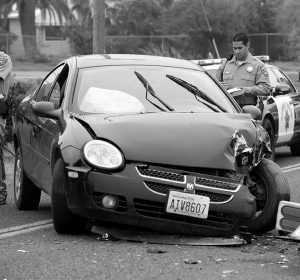 A CHP OFFICER investigates the crash site Thursday, Jan. 15, 2015 on Road 244 near Avenue 196 in Strathmore, Calif., USA. The stolen car was spotted and led to the car chase. The car collided to a truck near orange grove. The driver and two other passengers of truck had no major injuries.