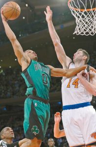 BOSTON CELTICS GUARD Avery Bradley (0) goes up against New York Knicks forward Jason Smith (14) during the second half of NBA basketball game on Tuesday at Madison Square Garden in New York. The Celtics won 108-97.