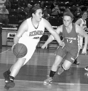 RICHMOND'S EMILY DOUIN (50) dribbles past Vinalhaven's Ashley Davis-Oakes during Friday's Western D semifinals at the Augusta Civic Center. The Bobcats won, 35-28.
