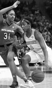 TENNESSEE GUARD JORDAN REYNOLDS (0) drives to the basket as South Carolina guard Asia Dozier (31) defends during the second half of an NCAA college basketball game on Monday in Columbia, S.C. South Carolina won, 71-66.