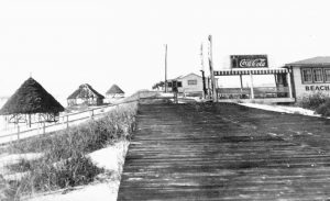 A PHOTO FROM the 1950s shows the Tower Beach boardwalk and casino on Okaloosa Island, Fla. Developed by longtime area resident Thomas Brooks, the boardwalk and casino were among the island's first attractions that would later include a large amusement park.