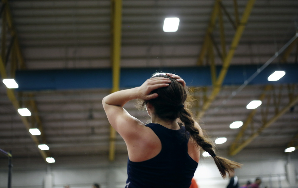 FEB. 16: CLASS B GIRLS INDOOR TRACK Emma Egan of Yarmouth has that yes-I-did-it moment after setting her state record in the high jump.