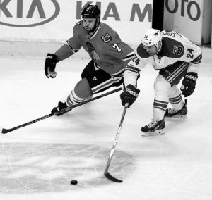 CHICAGO BLACKHAWKS defenseman Brent Seabrook drives on Arizona Coyotes center Kyle Chipchura during an NHL hockey game on Monday in Chicago.