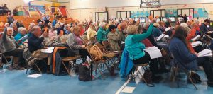 HARPSWELL RESIDENTS take a vote during the annual Town Meeting at the Harpswell Community School on Saturday.