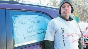 TIMOTHY HALPIN of Harpswell shows his support for the proposed train layover facility.