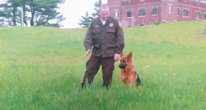 CPL. IAN ALEXANDER of the Sagadahoc County Sheriff's Department is pictured with a young police dog, Rocko, at the Maine Criminal Justice Academy in Vassalboro. Rocko retired in 2012 and died early on March 10 after enjoying 12 years with Alexander.