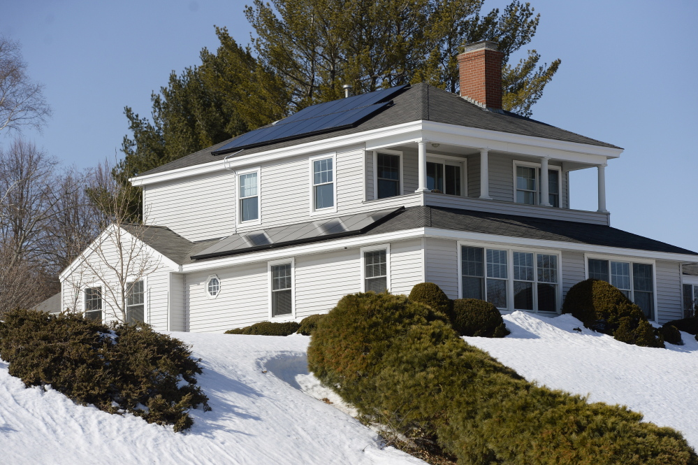 A home on Clifton Street in Portland is outfitted with solar panels. Gov. Paul LePage has opposed subsidies for renewable energy because he says they raise electric rates.
