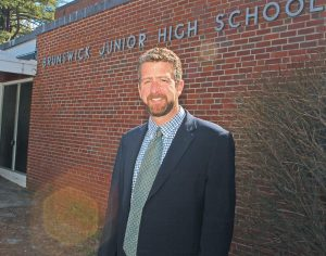PRINCIPAL WALTER WALLACE shown at Brunswick Junior High School on Tuesday.