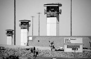 GUARD TOWERS AT HIGH DESERT STATE PRISON in Indian Springs, Nev., one of Nevada's toughest prisons, are seen in this April 15 file photo. Attorneys for two inmates involved in a deadly prison brawl are accusing prison guards of instigating the fight to set up a gladiator-style contest and then trying to cover it up by blaming the surviving prisoner.