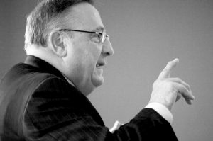 GOV. PAUL LEPAGE speaks to the Southern Midcoast Maine Chamber in Brunswick, where he touted his $6.57 billion biennial state budget proposal in this April 2 file photo.