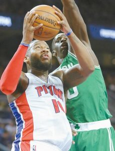 DETROIT'S Greg Monroe (10) goes to the basket against Boston's Brandon Bass (30) during the first half of an NBA basketball game on Wednesday in Auburn Hills, Mich.