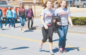 FREEPORT HIGH SCHOOL students, faculty and staff took to the streets Thursday April on a 2.1- mile loop through downtown Freeport in support of The Thirst Project and The V Foundation. It was part of the school's annual Fit For Charity walk, organized by the FHS Interact Club and Jobs For Maine Graduates.