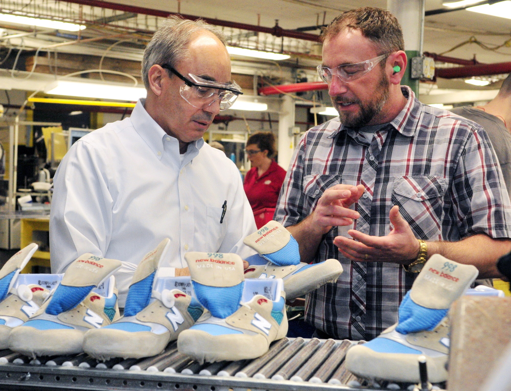 U.S. Rep. Bruce Poliquin, R-2nd District, left, and plant manager Chuck Campbell discuss model 998 shoes during a tour of the New Balance factory on Friday in Norridgewock.