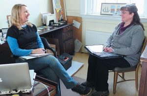 MARI EOSCO, left, interim director of Main Street Bath, and Alison Freeman, manager of the Bath Regional Information Center, engage in a discussion at the Main Street Bath office.