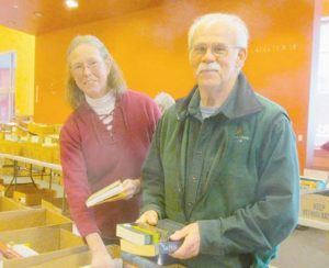 """Volunteers Pam and Brent Spooner of Phippsburg help sort thousands of donated books for the Mid Coast Hospital Auxiliary's annual Spring Used Book Sale Thursday, April 2, and Friday, April 3. The sale will take place from 8 a.m. to 4 p.m. Thursday and 8 a.m. to 3 p.m. Friday, at the Mid Coast Hospital Café Conference Rooms, 123 Medical Center Drive in Brunswick. The proceeds of the sale will benefit health career scholarships for area Midcoast students (who must apply by April 15 with the application on www.midcoasthealth.com/volunteer). Jean Cyr, book sale chairperson for the Auxiliary, encourages patrons to take totes for their books and to enjoy the """"hunt"""" in search of a special title. """" You never know what books you are going to find at our sale,"""" she said. """"We have a huge number of books this year, thanks to so many generous donors."""""""