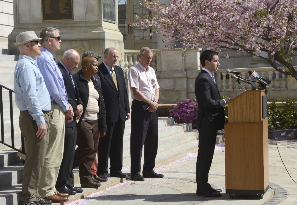 Portland City Councilor Justin Costa speaks out against racism and bigotry with other elected leaders in front of Portland City Hall on Thursday.