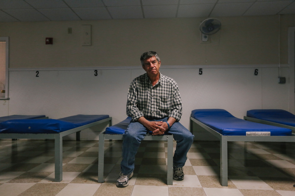 Chris Muse, 58, sits in the male dormitory of Portland's Oxford Street Shelter. Muse, a former state legislator, lost his home after it was condemned by the city of South Portland because of a broken sewer pipe. He has been homeless ever since. Whitney Hayward/Staff Photographer