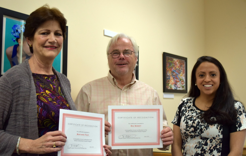 Helena Ackerson, right, chair of the school committee for the Wells-Ogunquit Community School District, presents certificates to the district's community resource coordinator Maryanne Foley and public information officer Reg Bennett for their leadership in the annual Literary Achievement Awards.