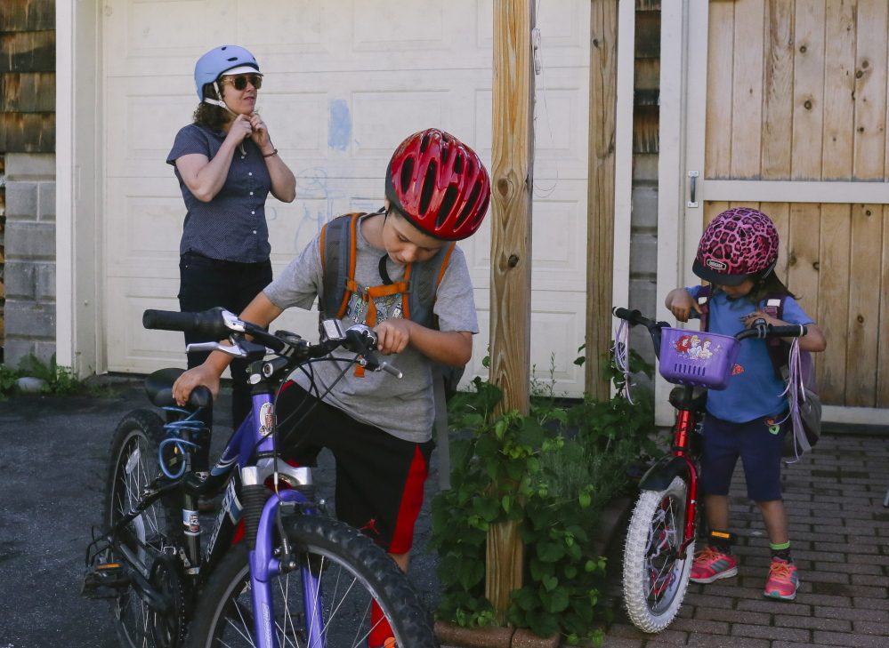 Welsch gets ready for her morning commute with Charlotte and son Levi Pelletier, 8.