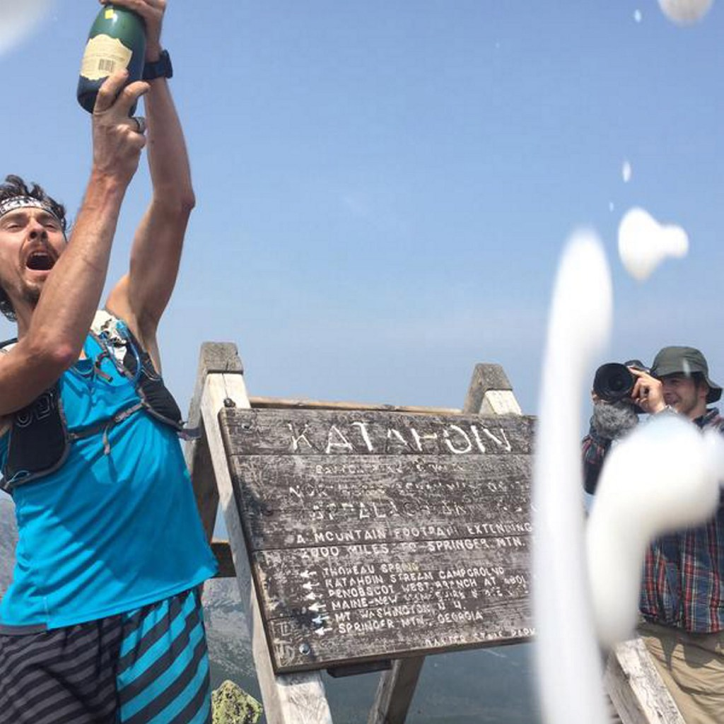 Scott Jurek's celebration at the top of Mount Katahdin led to charges of drinking in Baxter State Park, hiking with a group larger than 12 people and littering – when champagne sprayed into the air and hit the ground.
