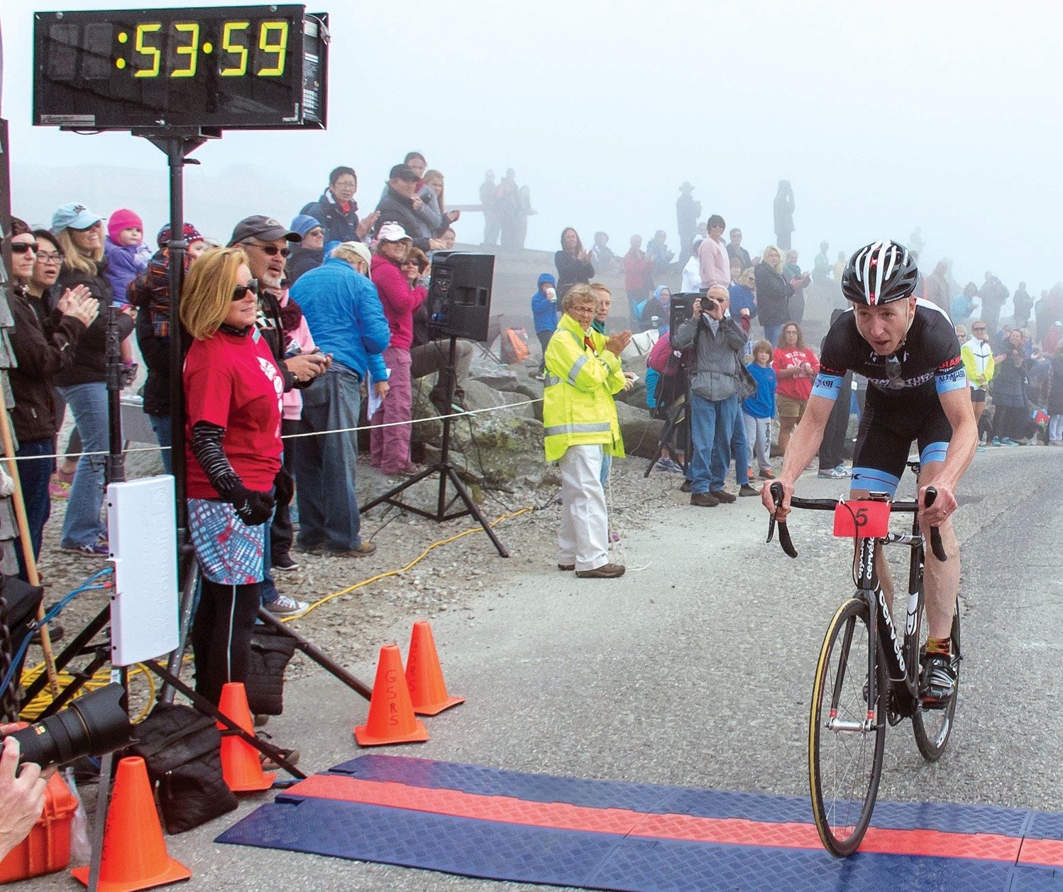 Sanford's Eric Follen crosses the finish line in second place at the 43rd Mt. Washington Auto Road Bicycle Hillclimb last weekend.