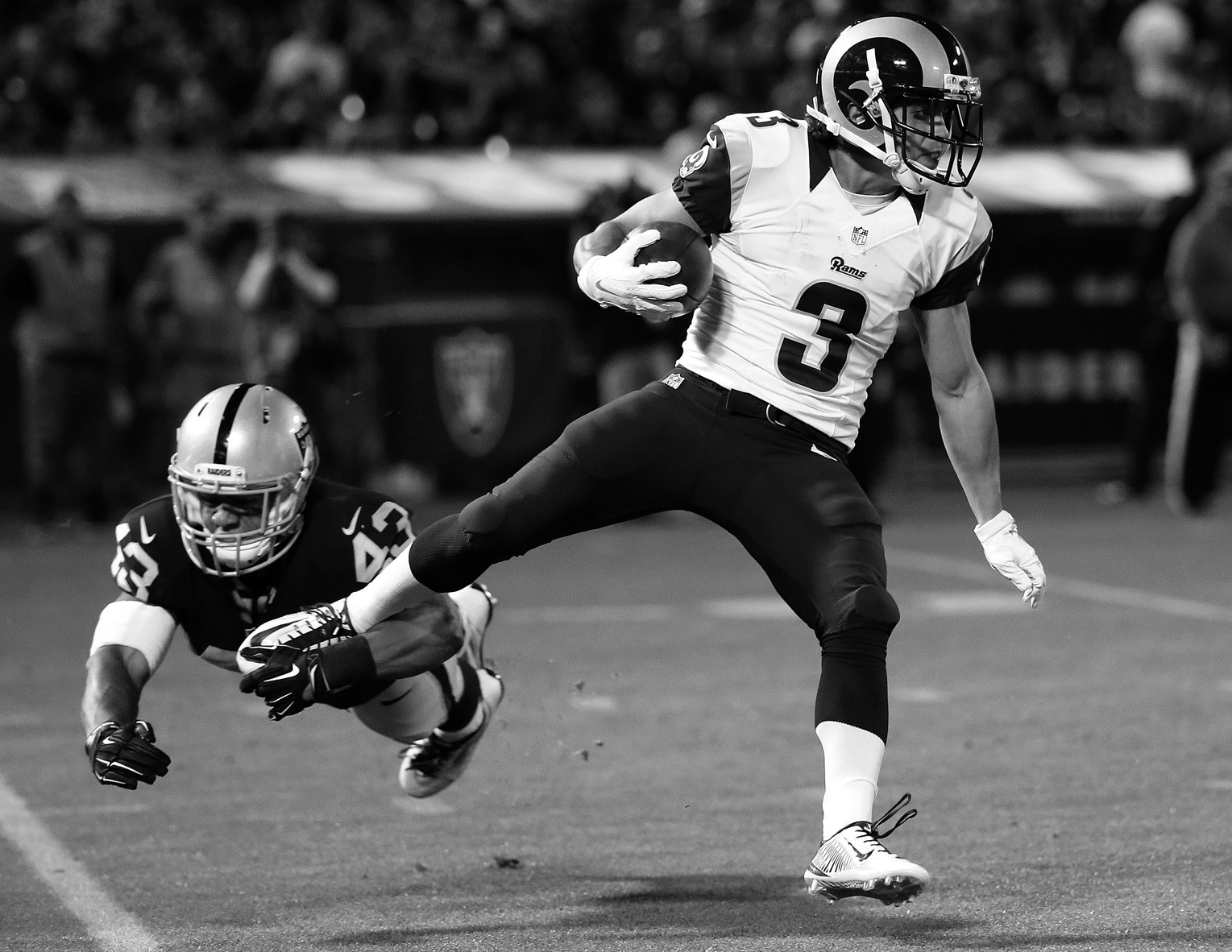 In this Aug. 14, file photo, St. Louis Rams wide receiver Daniel Rodriguez (3) runs past Oakland Raiders linebacker Jimmy Hall (43) during the second half of an NFL preseason football game in Oakland, Calif. Long after the rest of the St. Louis Rams have left the practice field, Daniel Rodriguez drips with sweat running dozens of extra pass routes from backup quarterback Austin Davis. No one can tell the fearless 27-year-old rookie with the unique back story, a decorated Army veteran, that he's nothing more than a training camp feel-good story.