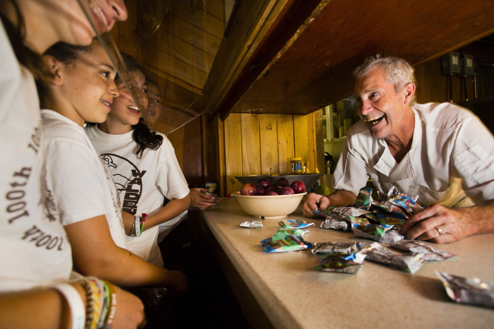 Chef Jonny St. Laurent chats with campers over the snack counter at Camp Walden in Denmark.