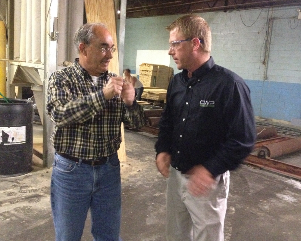 U.S. Rep. Bruce Poliquin, a Republican from Maine's 2nd District, left, speaks with Brody Cousineau, vice president of Cousineau Wood Products, during a Tuesday tour of the company's North Anson facility.