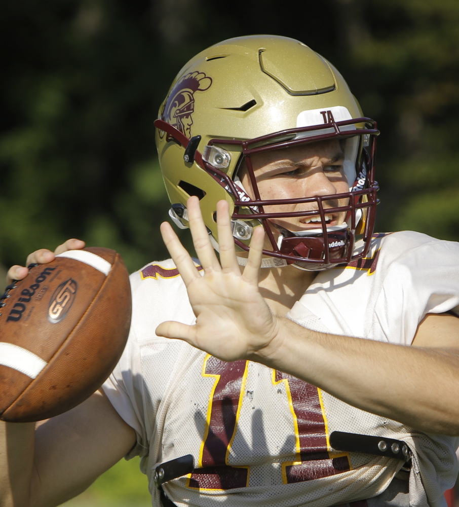 Thornton Academy quarterback Austin McCrum and teammates will use a new helmet designed to absorb impacts better and minimize concussions.