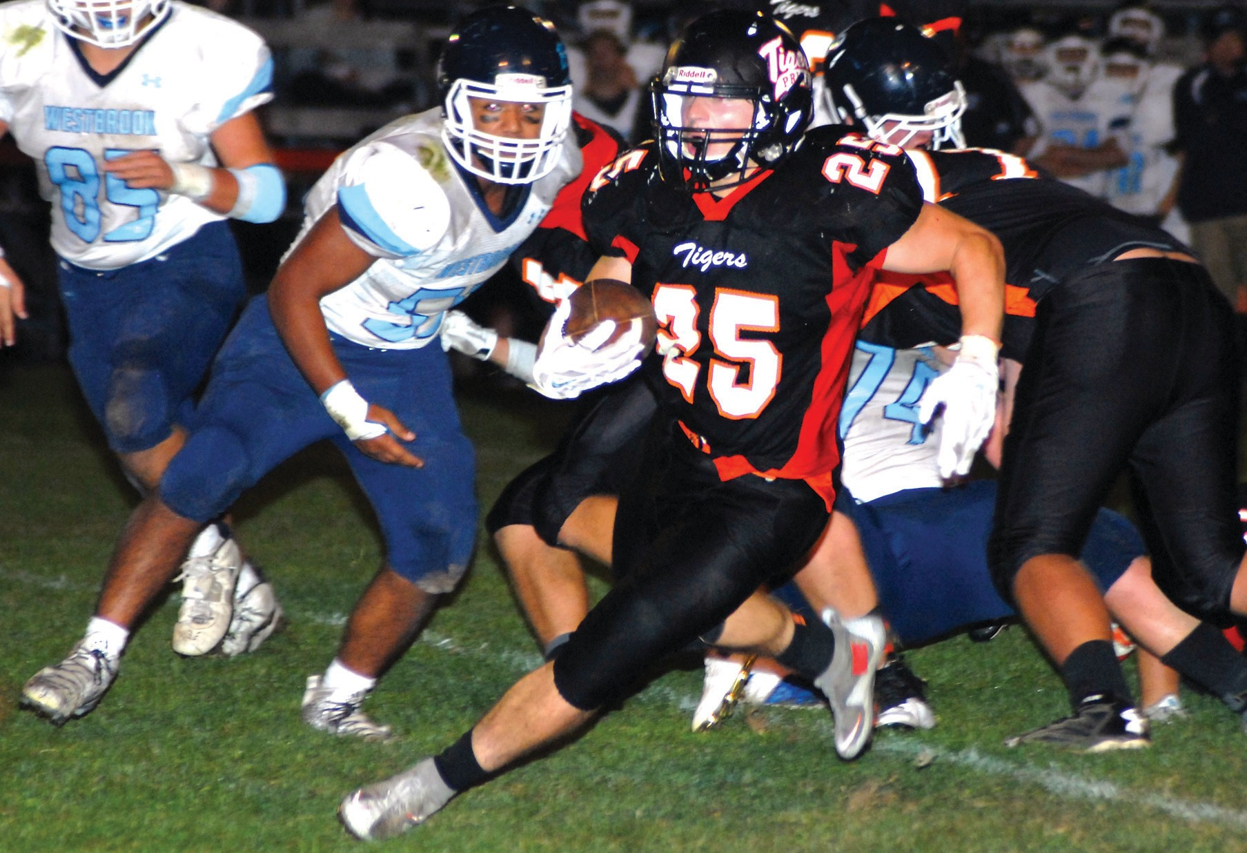 Biddeford's Lucas Rhoy sprints for a 22- yard touchdown against Westbrook on Friday night at Waterhouse Field.