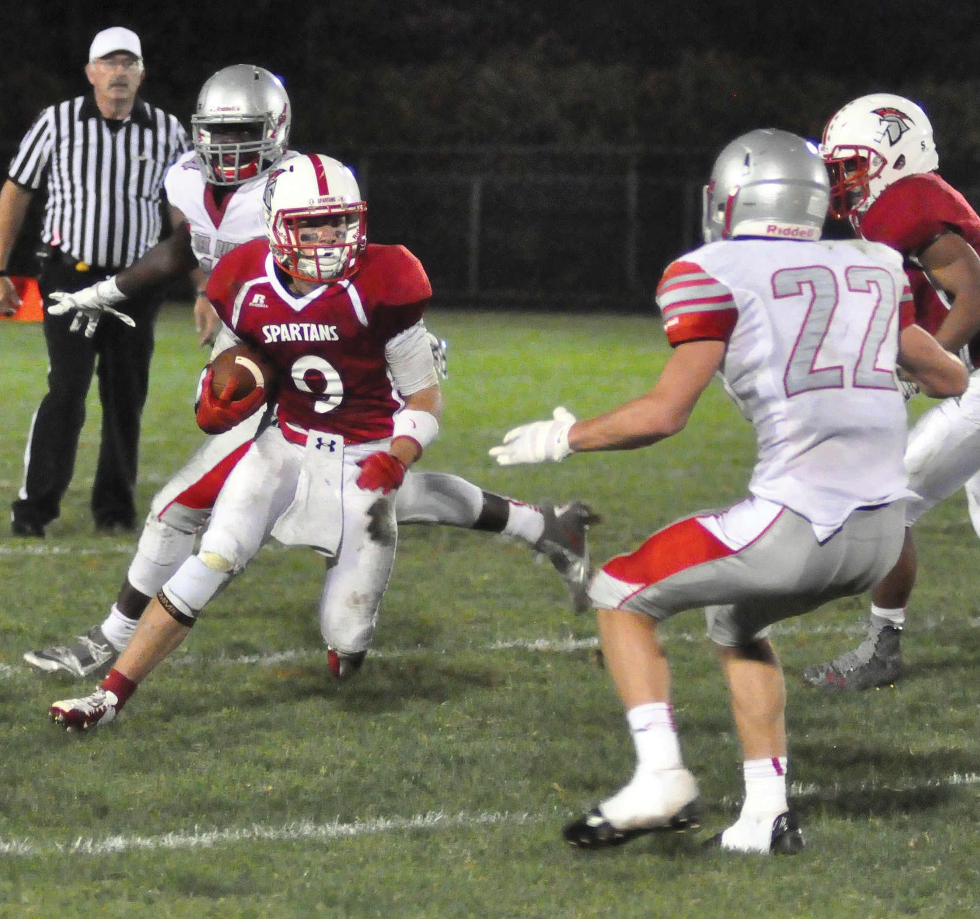 Sanford's Peter Hegarty (9) looks to make a move against South Portland's Spencer Houlette (22) during the first half of the Spartans' 25- 0 victory at Cobb Stadium in Sanford Friday night.
